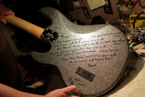 "A custom Music Man bass inscribed & given in appreciation to Daniel by  Matchbox Twenty's Brian ""Pook"" Yale."